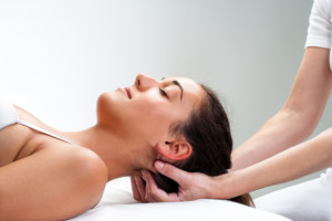 Chiropractor treating neck
