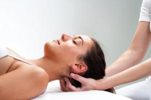 Chiropractor treating neck